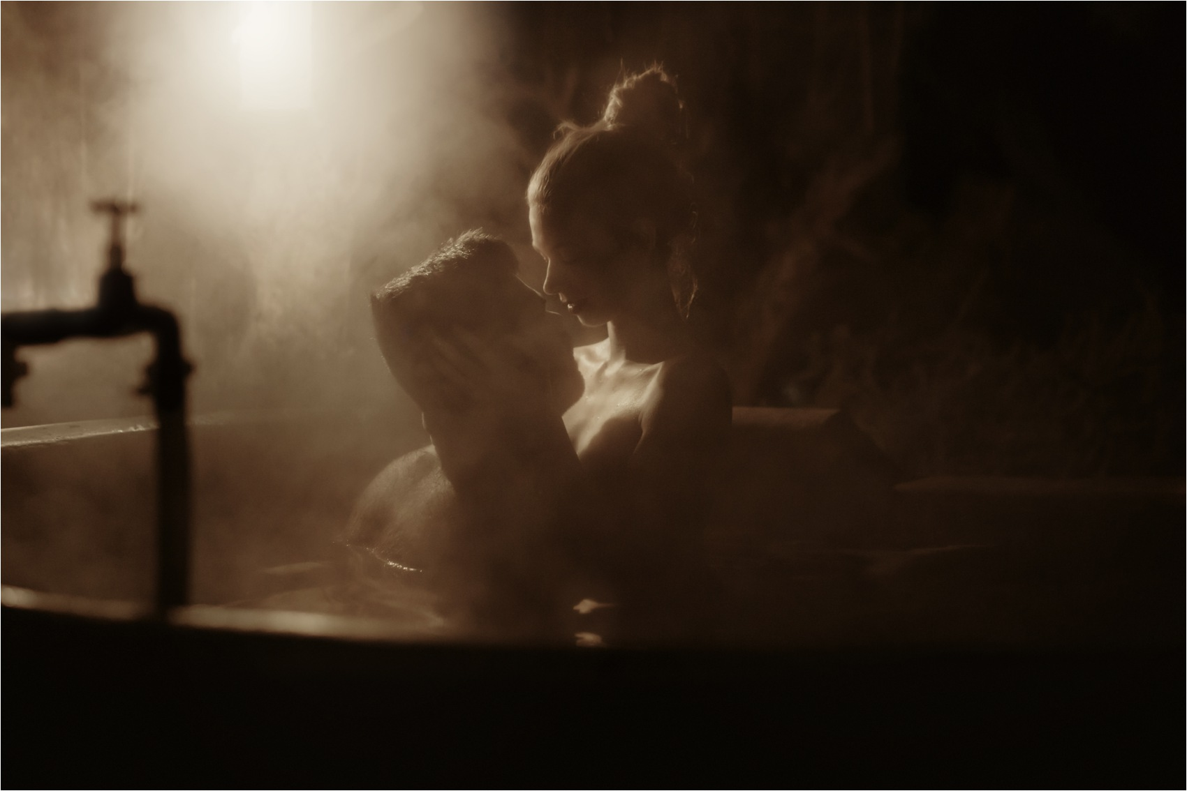 romantic kiss in bathtub