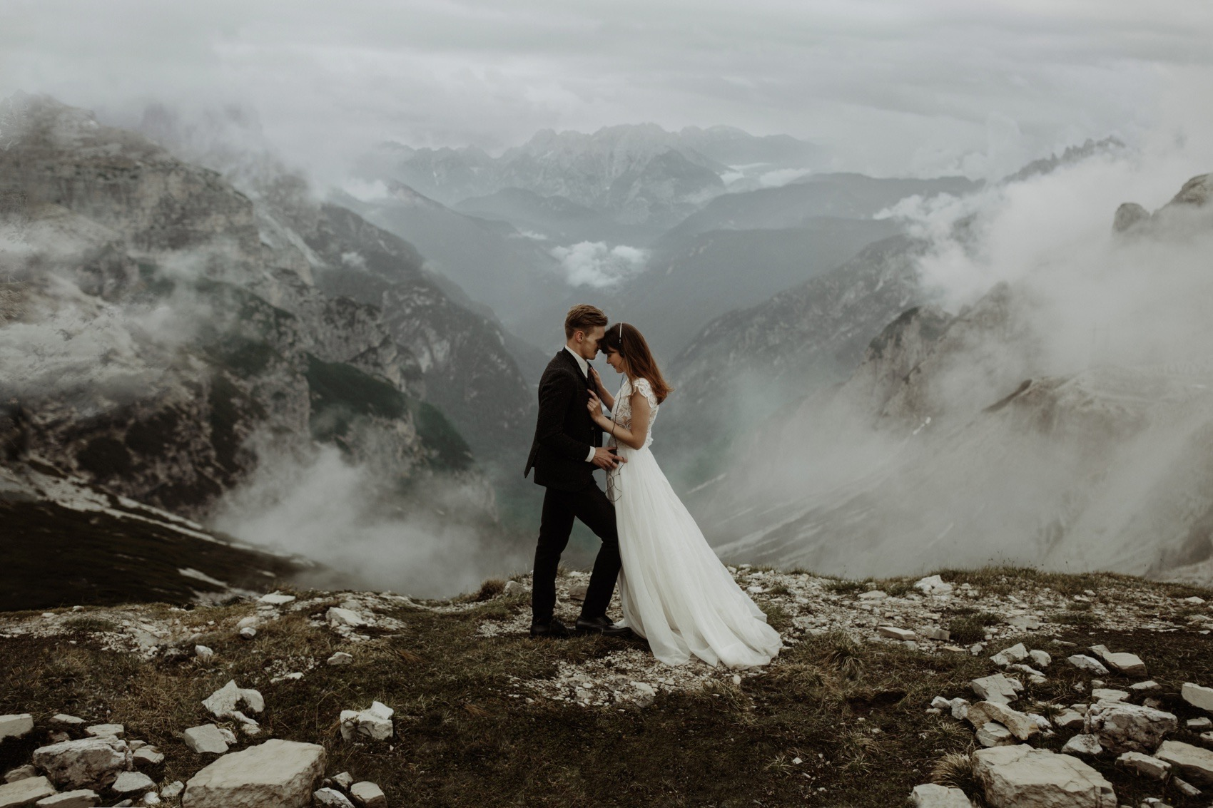 wide shot couple on a mountain peak