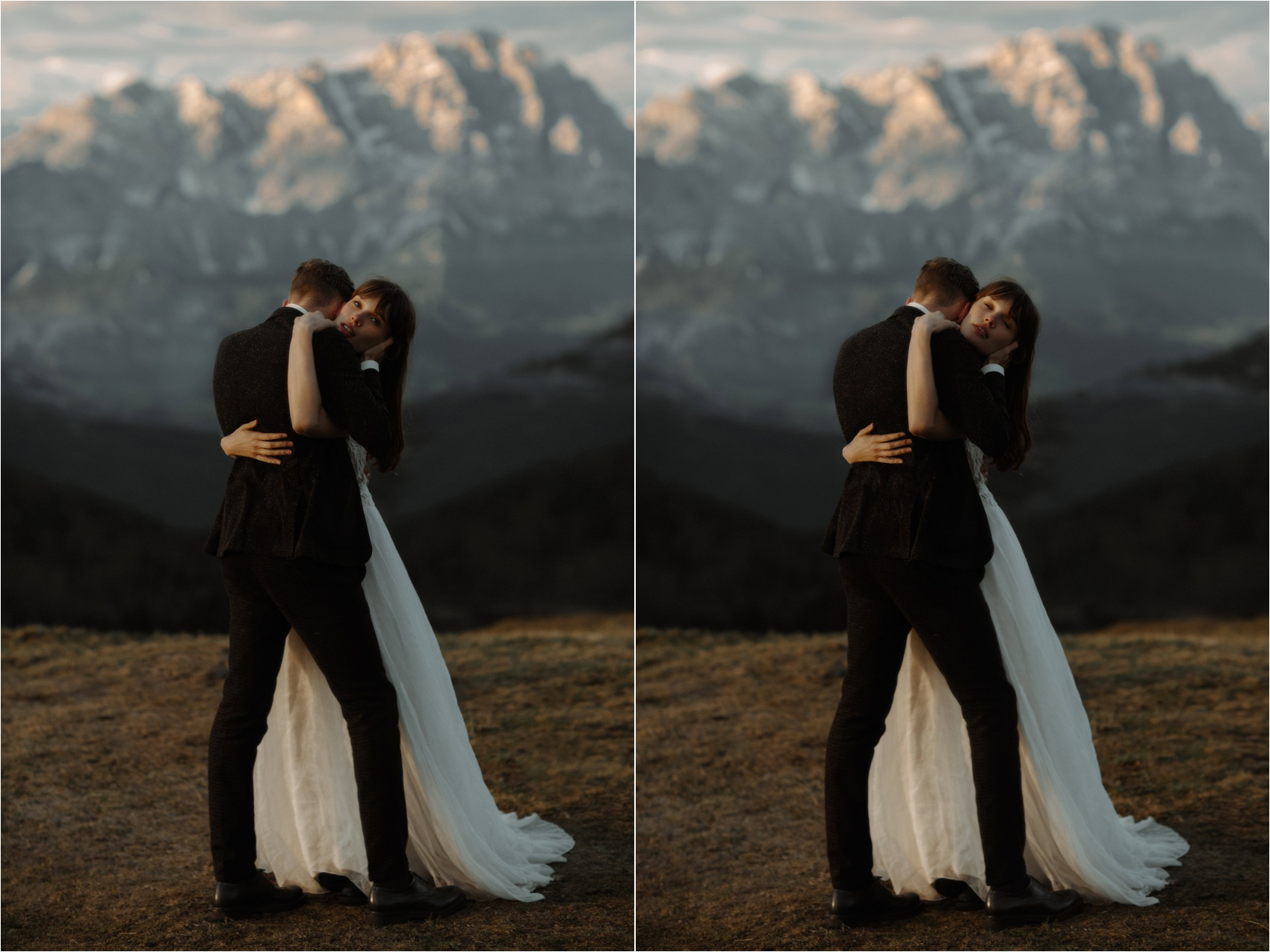 couple hug standing in front of a mountain