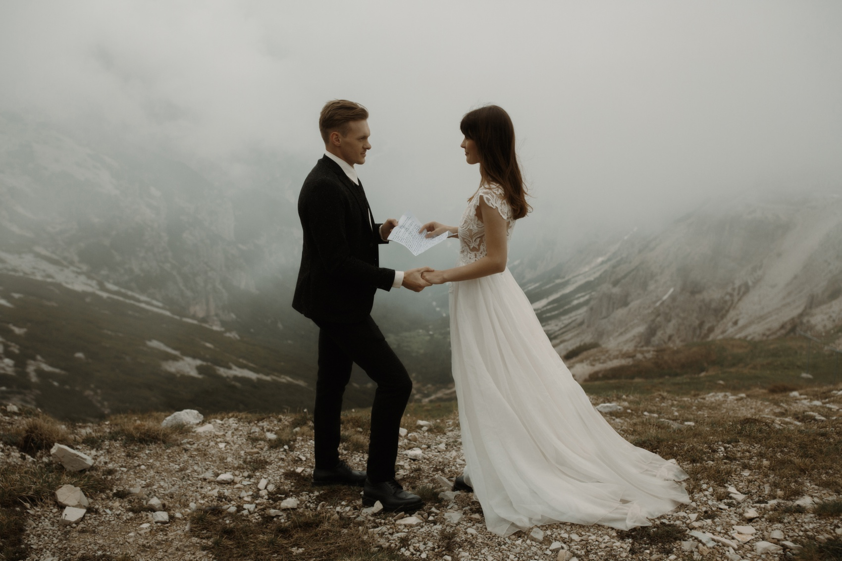couple standing on a mountain