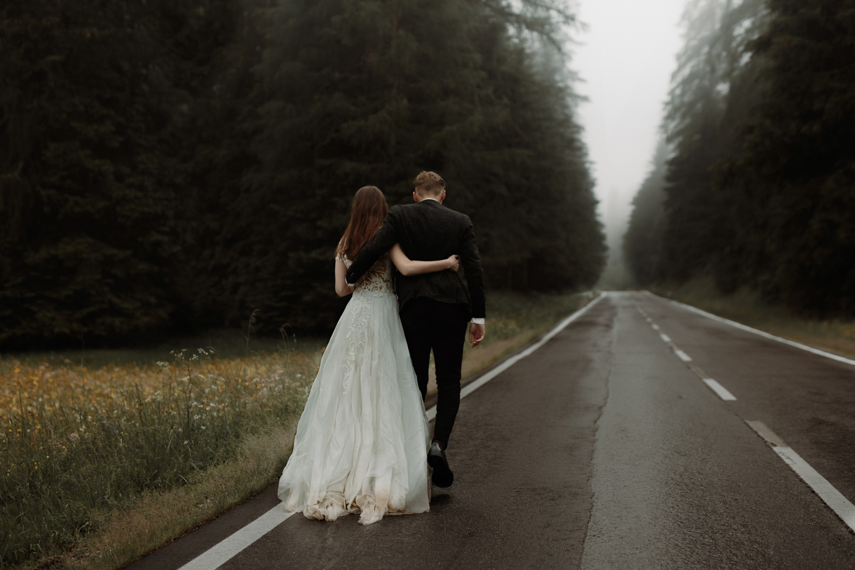 couple walking on an empty road